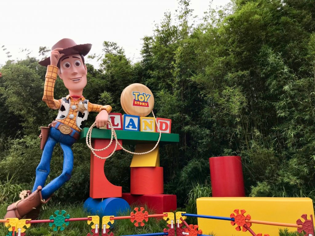 Woody is there at the entrance to meet you at Toy Story Land